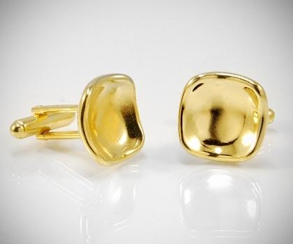 Gemelli per camicia dorati rivoltati concavi