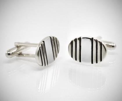Gemelli per camicia ovali righe acciaio